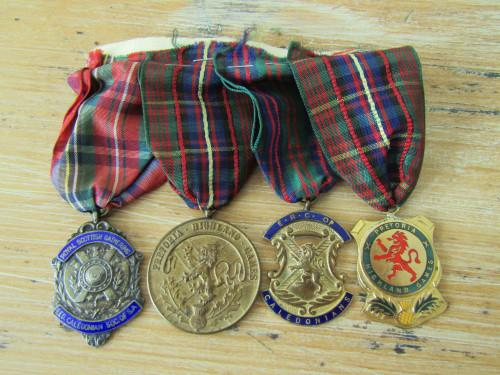 Set of 4 caledonian society medals with ribbons, one in