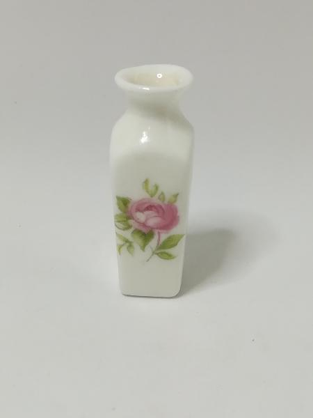 White vase with a beautiful flower - miniature