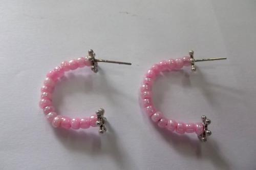 Fashion jewellery, hoop type earrings with plastic bullet