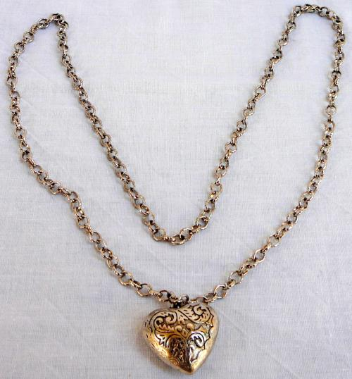 Heart pendant on silver coloured chain