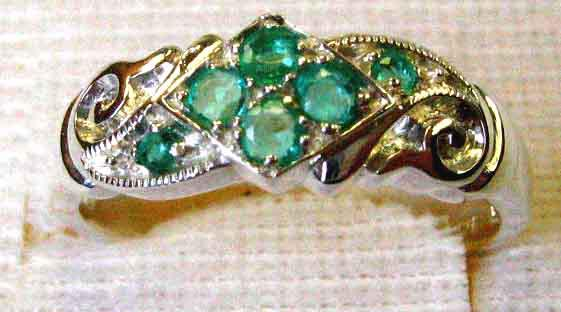 Lovely - sterling silver and genuine emeralds ring.