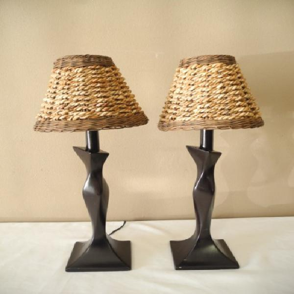 A lovely pair of wood table lamps with wicker shades