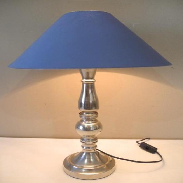 A modern silver metal lightweight coffee table lamp with a