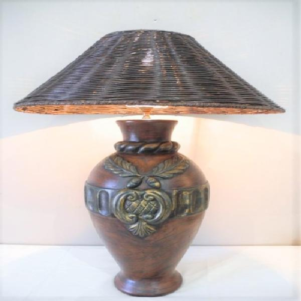 A stunning large molded ceramic table lamp with a wicker