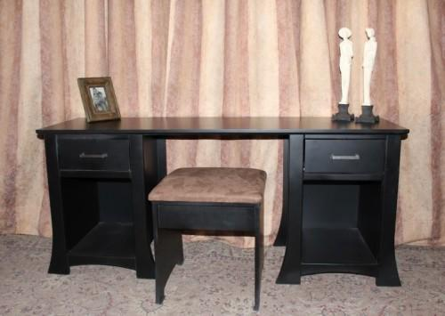 A stunning modern styled black wooden dressing table with