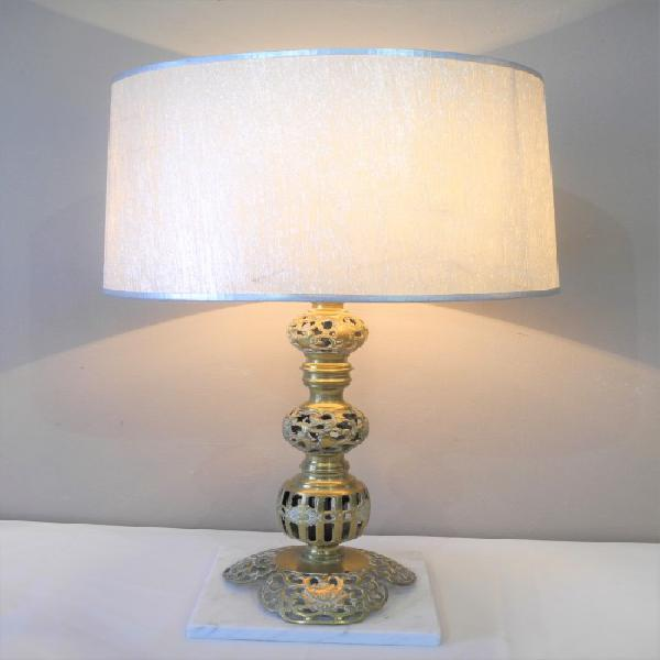 A stunning vintage brass and marble base table lamp with a