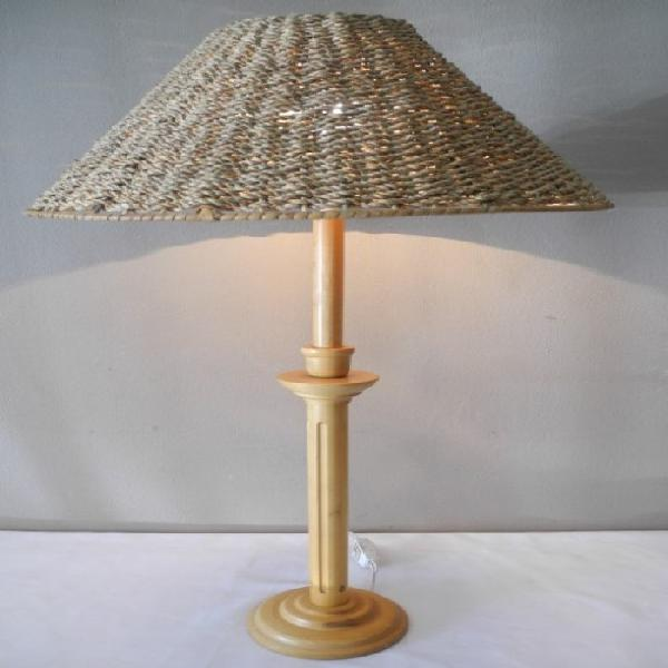 A wonderful lightweight wood table lamp with a wicker shade