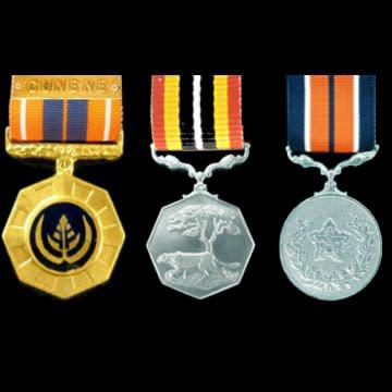 Grouping of 3 numbered full size medals with ribbons.
