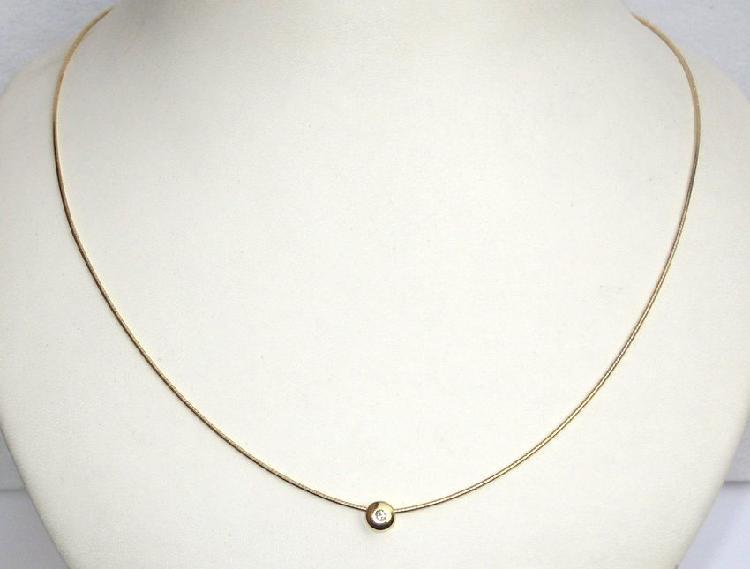 9k / 9ct gold slider necklace: simulated diamond pendant.