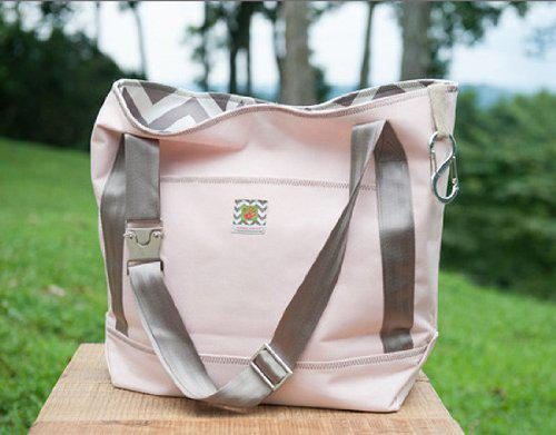On the move tote diaper bag color: pink / green