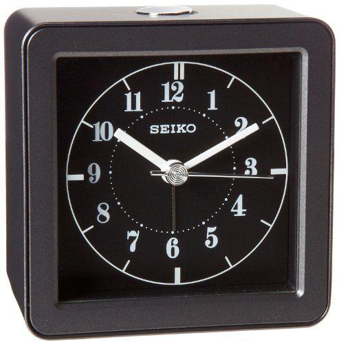 Seiko qhe082jlh beside alarm clock