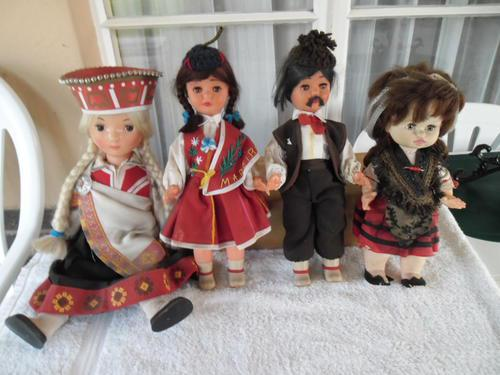 Four collectable vintage dolls