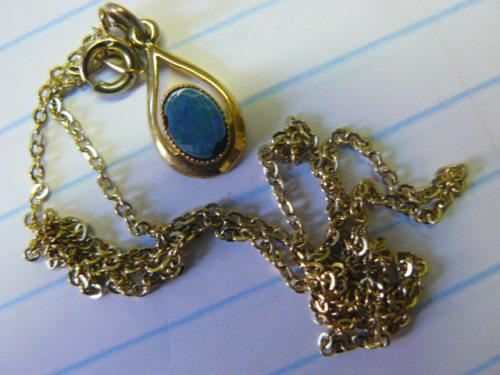 Gold plated chain and pendant could be opal