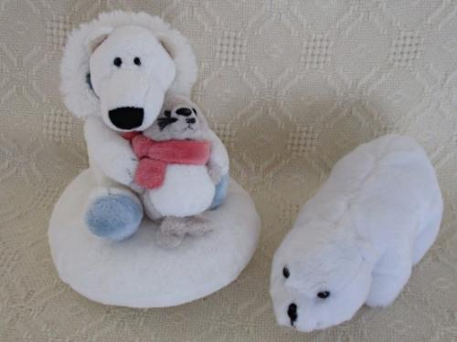Relisted - a nici polar bear holding a baby seal and his