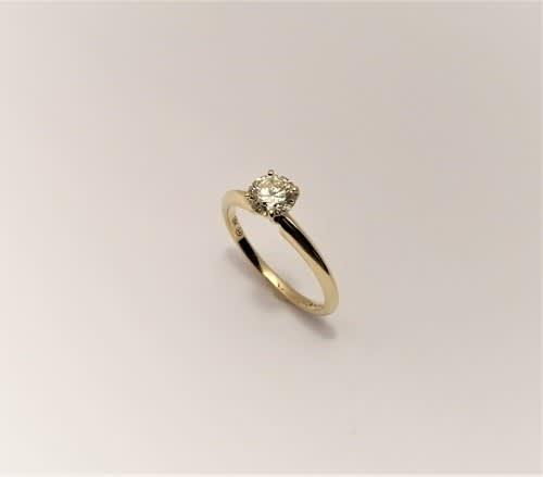 0.54 cts solitaire ring set in 18k yellow gold