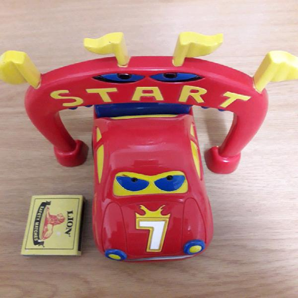 Red plastic toy car