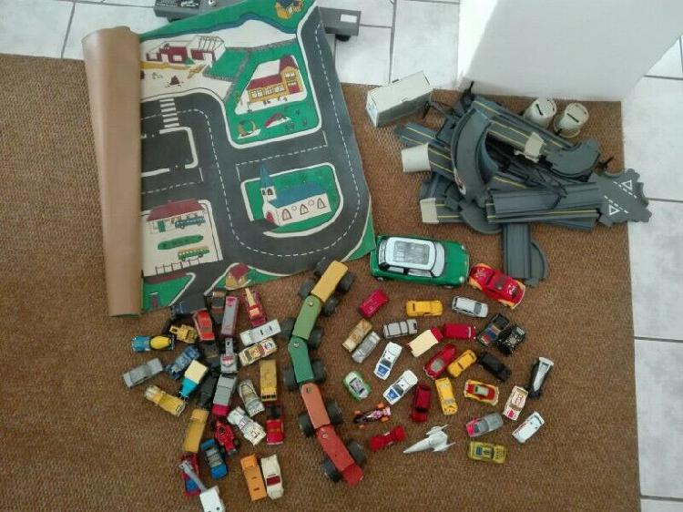 Collection of matchbox and other cars and related items.