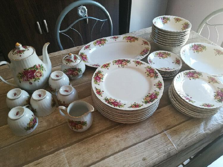 40 piece royal china english rose gold platted dinner set.
