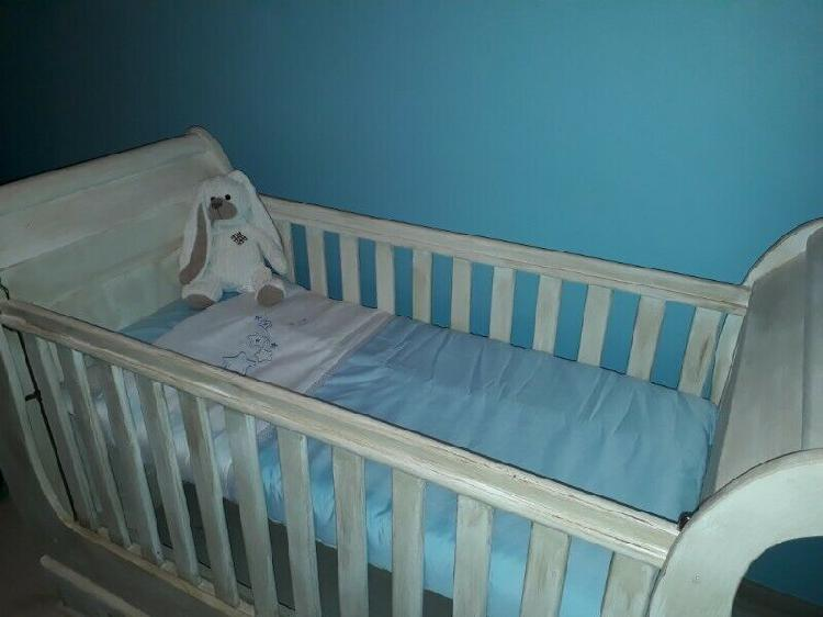 Sleigh cot and changing table