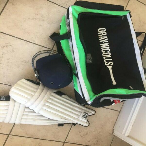 Cricket bag, helmet + pads