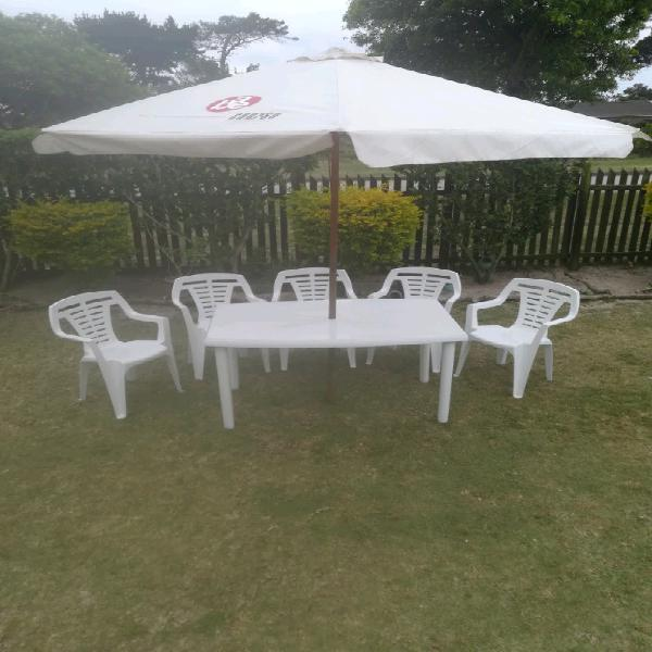 Table with chairs & umbrella