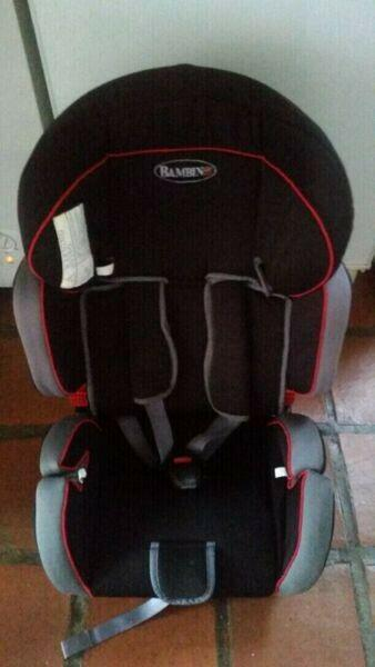 Bambino booster car seat for sale