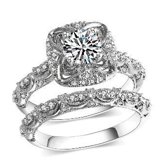Exquisitely detailed cr.diamond engagement & wedding ring