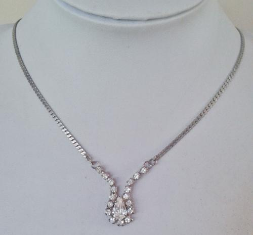 Silver tone chain necklace with a clear stone pendant