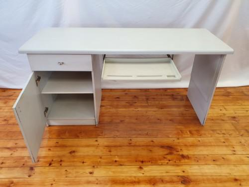 A modern melamine top desk with a pull out keyboard drawer.