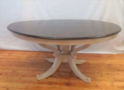 A stunning large dark wood and white base round dining table