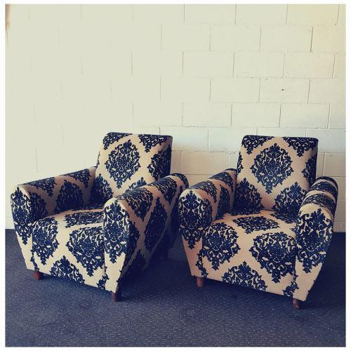 A wonderful pair of single sofa chairs upholstered in a