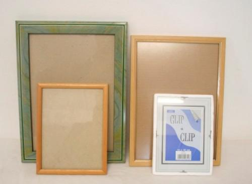 Four lovely medium sized assorted wall mounted photo frames