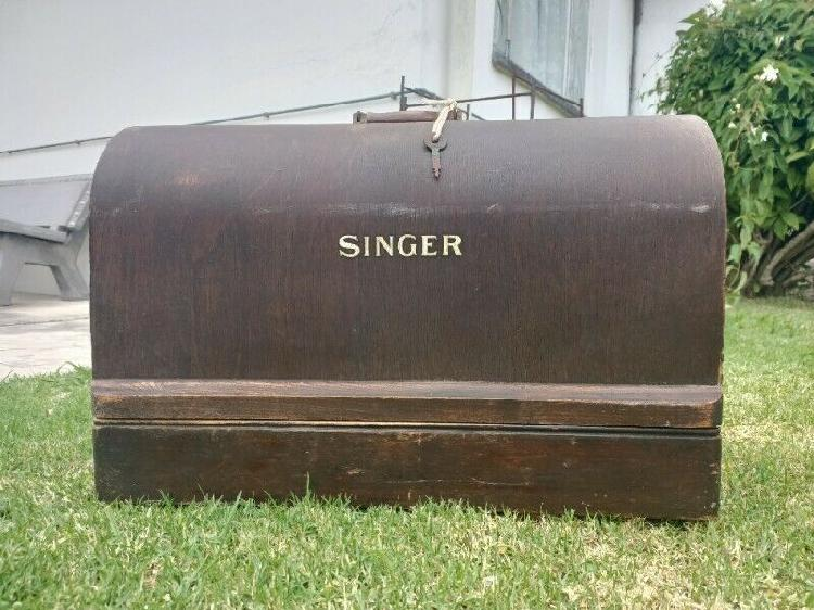 Antique singer sewing machine with attachments