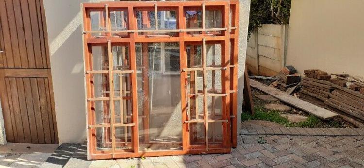 Solid meranti windows with glass and burglar bars for sale