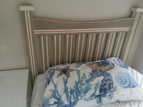 Two single bed wooden chalk painted french linen headboards.