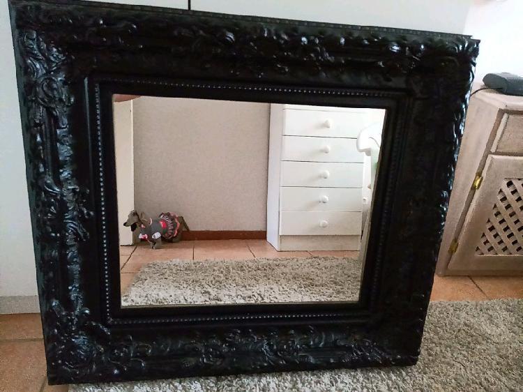 Black Mirror with design around the frame