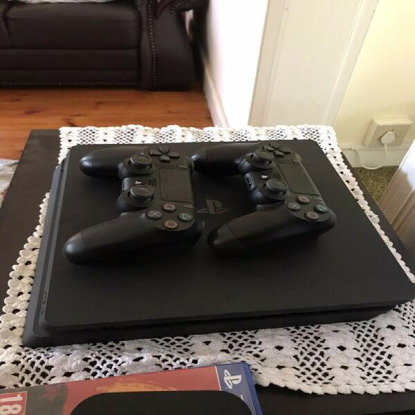 Ps 4 with two controllers and 4 games (barely used)