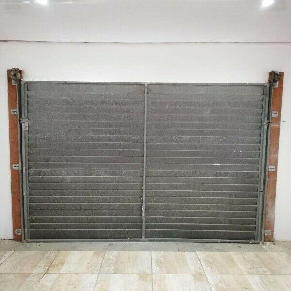 Garage door with rails and counter-balance weights