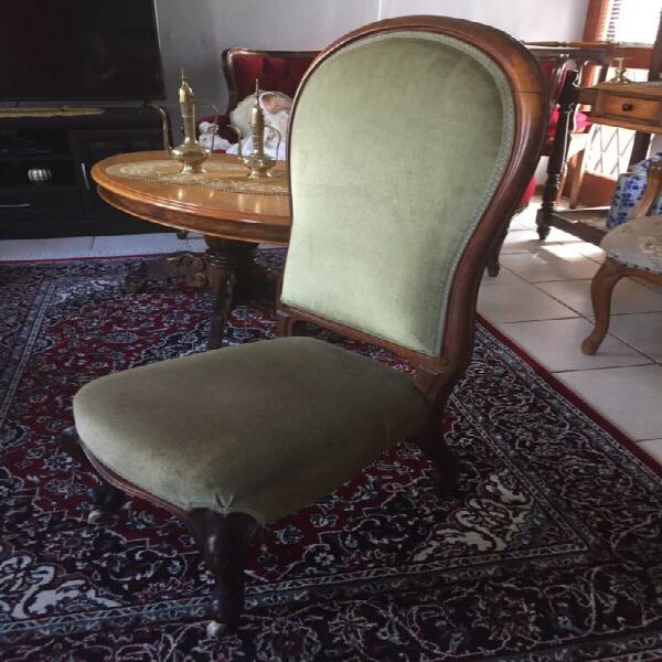 Antique feeding chair with wheels