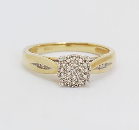 Diamond cluster style ring in 9k yellow gold