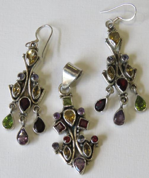 Sterling silver earrings and pendant set with various stones
