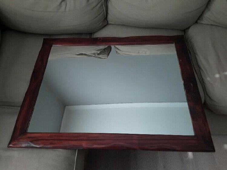 Solid dark wood mirror