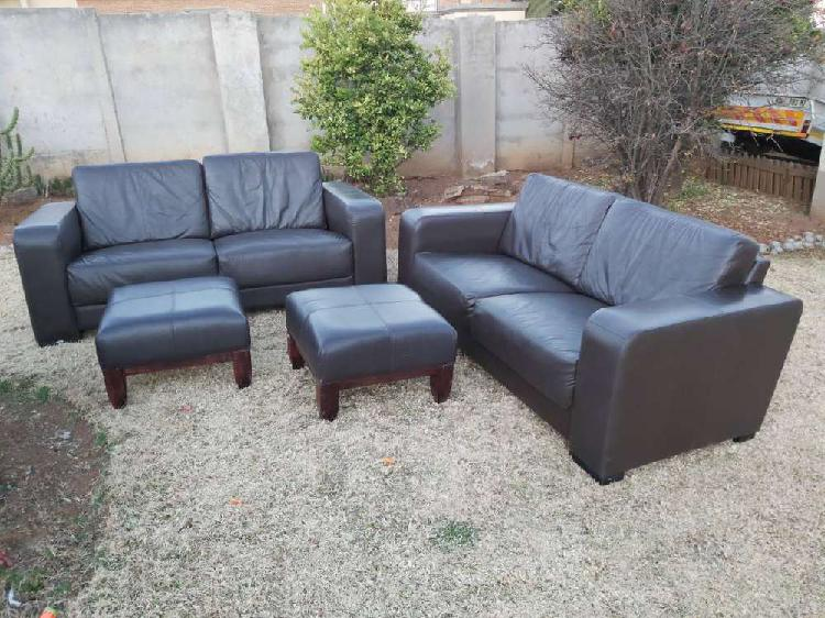 R13000 genuine leather 2 x 2 seater couches and x2 ottomans.