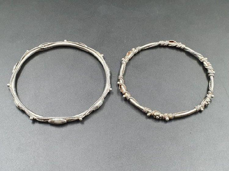 A pair of stainless steel ladies fashion bangles