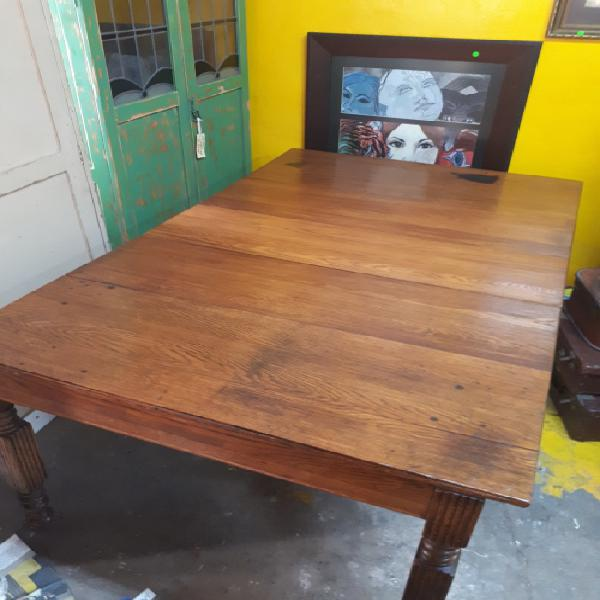 Victorian oak sliding table on original casters by the