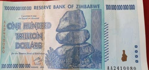 Rare and sought after zimbabwe 100,000,000,000,000 dollars
