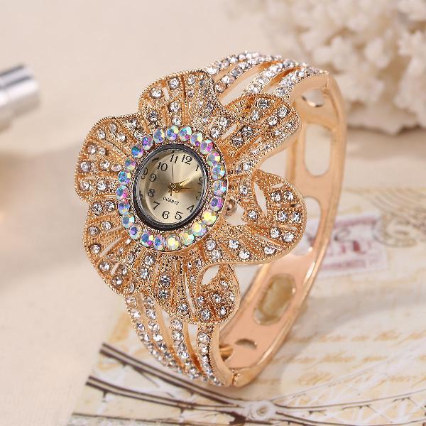 Fashion crystal flower shape dial hollow metal strap women