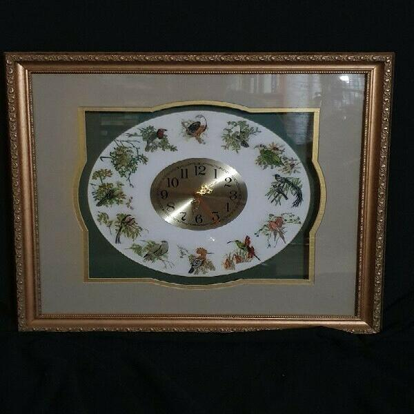 Clock surrounded by embroidered birds of south africa with a