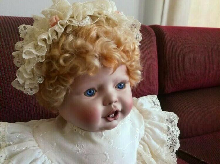 Handcrafted porcealin doll.