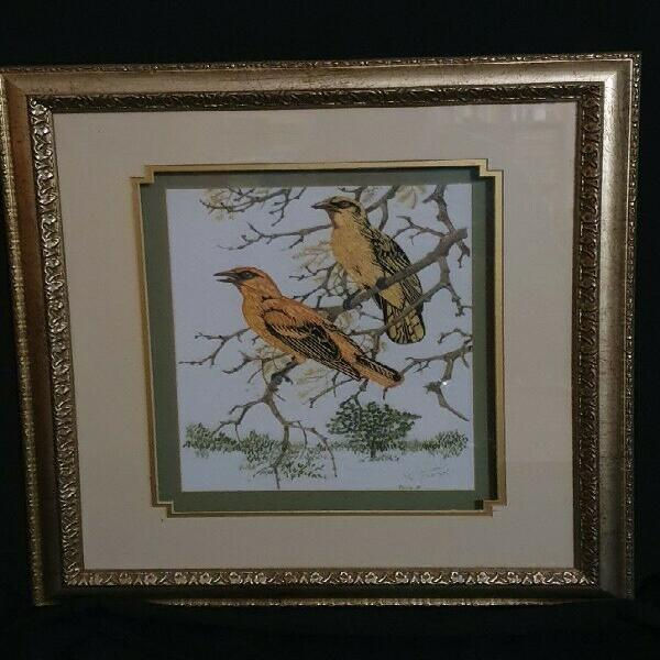 Wall hanging of two golden weavers, embroidered and framed